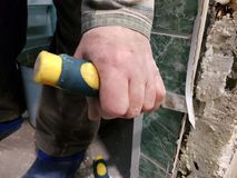 Repair - tool chisel in the hands of the builder. Or finisher stock image