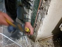 Repair - tool chisel in the hands of the builder. Or finisher royalty free stock photos