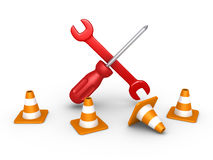 Repair tools behind traffic cones Stock Image