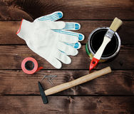 Repair tools. Gloves, hammer, paint brush, electrical tape, repair the house royalty free stock photography