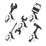 Repair tools in hand. Silhouette set Royalty Free Stock Images