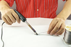Repair usb cable. Man repair a white usb cable by black soldering with lead Stock Photography