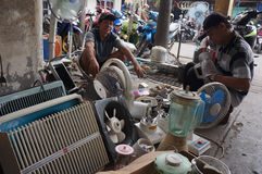Repair the used goods. The technician was repairing secondhand goods for resale in the city of Solo, Central Java, Indonesia royalty free stock image