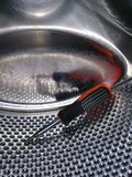 Repair of washing machines - the inside of the drum with a screwdriver inside stock image