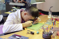 Repair watchmaker. Working carefully by his desk, xiamen city, china Stock Photography