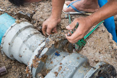 Repair water pipe Stock Photo
