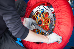 Repair of the wheel of a sports bike Stock Photography