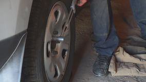 Repair wheels in the garage. Man replaces the wheel stock video footage