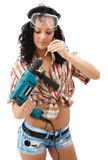 Repair woman with driller. A young sexy female worker with a drilling machine Stock Photos