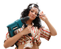 Repair woman with driller. A sexy female worker with a drilling machine in one hand and a drill-bit in the other hand Stock Images