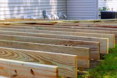 Repair of an wooden deck or patio with modern wood material. Repair of an wooden deck or patio with modern composite wood material stock photography