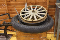 Repair Wooden Wheel. Wooden spooks wheel getting repaired Royalty Free Stock Photos