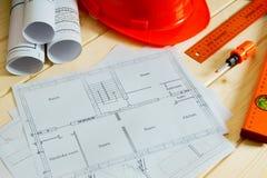 Repair work. Drawings for building, helmet Royalty Free Stock Photos