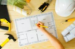 Repair work. Drawings for building, women hand Stock Image