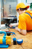 Repair work on fridge appliance. Repairman makes refrigerator appliance troubleshooting and maintenance works Royalty Free Stock Photos