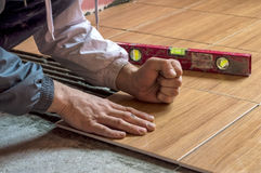 Repair work, laying tiles on the floor.  Royalty Free Stock Photos
