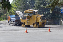 Repair work on the road. Road Construction Equipment will either repair the road stock image