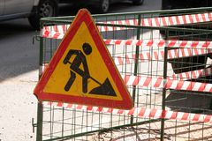 Repair work. Repair of roads on the streets. The construction site of the streets of the city with barricades and a network of. Description: Repair work. Repair royalty free stock photo