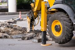 Demolition hammer excavator with wheel and bearing closeup stock photos
