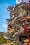 Repair Work Using Crane on metal spiral pipe for fire brigade downhill.  London. UK Stock Photos
