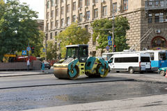 Repair works on replacement of an asphalt covering of roads in t Stock Photography