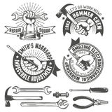 Repair workshop. Logo with hands and tools in vintage style. Hand tools. Text on a separate layer - easy to replace Royalty Free Stock Photos