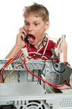 Repair your computer. A young man calls to technical support Royalty Free Stock Photo