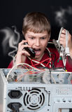 Repair your computer. A young man calls to technical support Royalty Free Stock Image