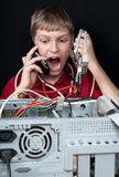 Repair your computer. A young man calls to technical support Stock Photography