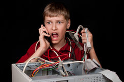 Repair your computer. A young man calls to technical support Stock Photos
