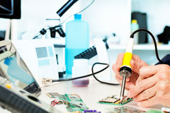 Repaired. By soldering a PC board royalty free stock images