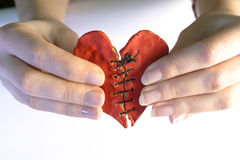 Repaired human heart. In hands royalty free stock image