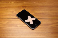Repaired smartphone with bandage Stock Photos