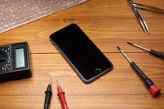 Repaired smartphone with tools Stock Photography