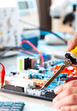 Repaired. By soldering a PC board royalty free stock photo
