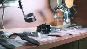Repaired watches at watch repair shop stock video footage