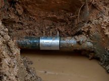 Repaired water pipe. With clamp Stock Photography
