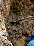 Repaired water pipe with shovel. Digging the earth to cracked pipes Royalty Free Stock Photo