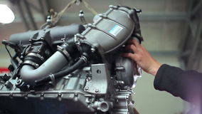 Repairer removes hoses from the engine stock video footage