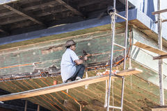 Repairig the boat Stock Photo