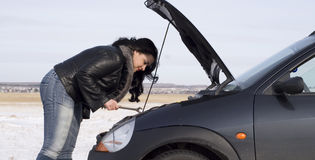 Repairing. Woman with her broken car Stock Image
