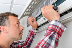 Repairing air conditioning unit Royalty Free Stock Photos