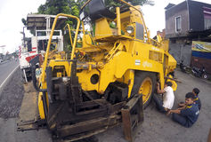 Repairing asphalt finisher Stock Photos