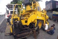 Repairing asphalt finisher Stock Photos