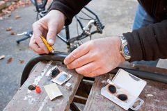 Repairing Bicycle Puncture Stock Images