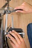 Repairing bike Stock Image