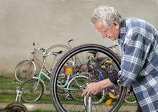 Repairing bike Royalty Free Stock Image