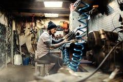 Repairing bike motor Royalty Free Stock Image