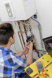 Repairing boiler expensive Stock Images