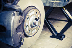 Repairing brakes on car Stock Images